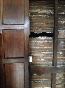 Behind the wood panelling is an earlier wall of the tudor period