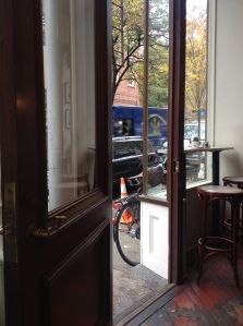 Looking out the door of the Minerva Cafe in the Village