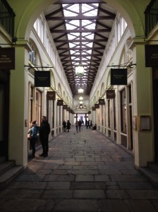 Elegant arcade made for wheelbarrows and patent leather shoes it seems